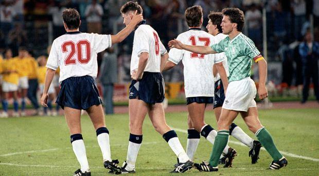 West Germany captain Lothar Mathaus (right) and England's Gary Lineker (left) console Chris Waddle after his penalty miss during the shootout in England's 1990 World Cup semi-final (Ross Kinnaird/EMPICS Sport/PA)