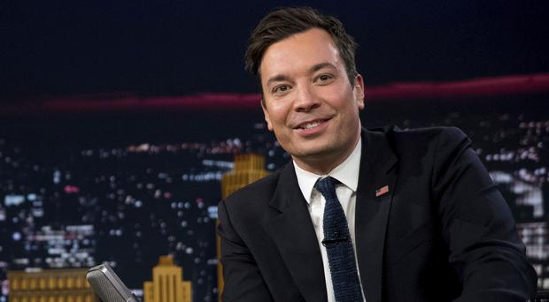 Jimmy Fallon has said he will make a donation to an immigration group in Donald Trump's name (AP Photo/Andrew Harnik)