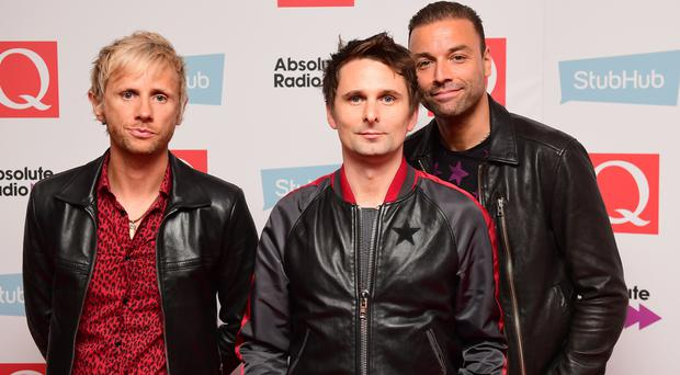 Dominic Howard, Matt Bellamy and Chris Wolstenholme of Muse (Ian West/PA)