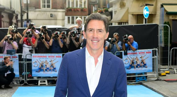 Rob Brydon has said he thinks male actors are under more pressure to look good in order to extend their careers. (Ian West/PA)
