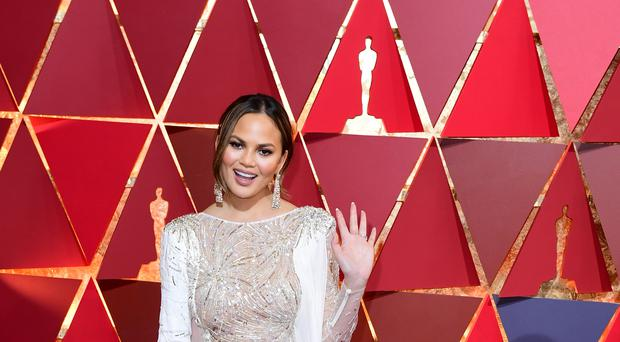 Chrissy Teigen has criticised President Donald Trump after he mocked the #MeToo movement (Ian West/PA)