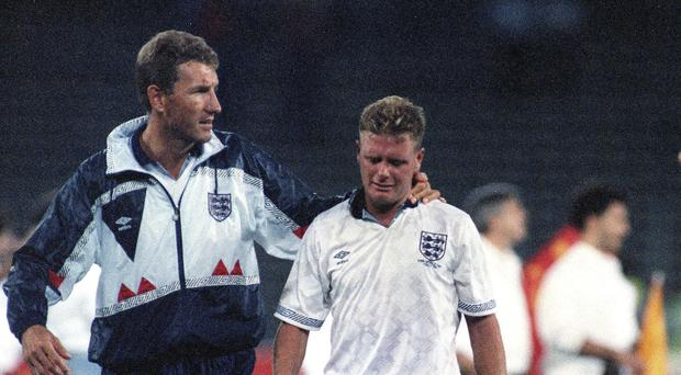 England's Paul Gascoigne and team captain Terry Butcher, after his England lost a penalty shoot-out in the semi-final match of the World Cup against West Germany in Turin, Italy (Image PA)