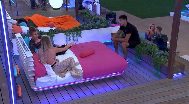 Jack is called over to clarify the situation over his date with Georgia (ITV)