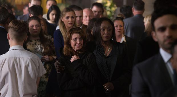 Shakil's mother Carmel cries at his funeral in EastEnders (Jack Barnes/BBC)