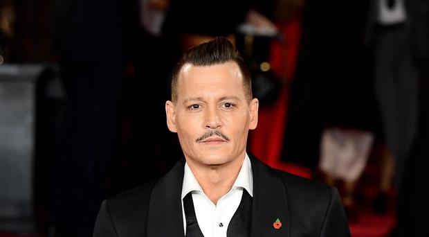Johnny Depp is being sued for allegedly punching a crew member on the set of upcoming film City Of Lies (Ian West/PA)
