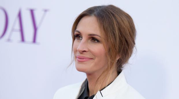Julia Roberts wished Tom Hanks a happy birthday on Instagram (Richard Shotwell/Invision/AP)