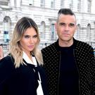 Robbie Williams and Ayda Field are the first couple to be on the X Factor judging panel together (Ian West/PA)
