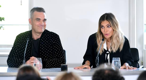 Robbie Williams and Ayda Field are joining the panel (Ian West/PA)