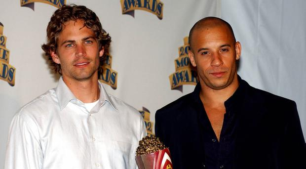 Paul Walker and Vin Diesel pose with their award for best on-screen team back stage at the 2002 MTV Movie Awards at Shrine Auditorium, Los Angeles (Anthony Harvey/PA)