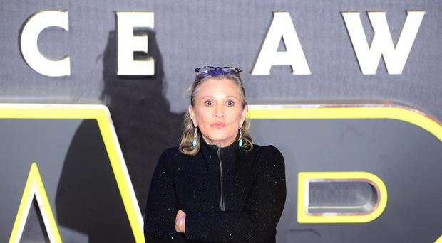 Carrie Fisher's brother has welcomed the news that she will feature in the next Star Wars film. (Anthony Devlin/PA)