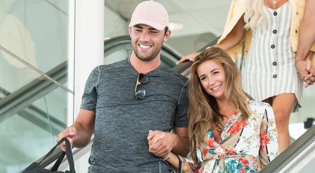 Love Island 2018 winners Dani Dyer and Jack Fincham arrive at Stansted Airport following the final of the reality TV show (Jeff Spicer/PA)