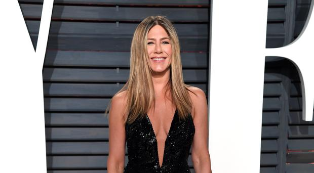 Jennifer Aniston says she is not heartbroken (PA)