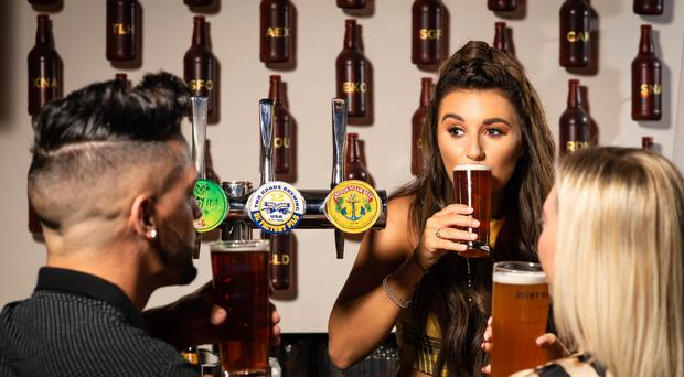 Love Island winner Dani Dyer has returned to pulling pints behind the bar (John Nguyen/PA)