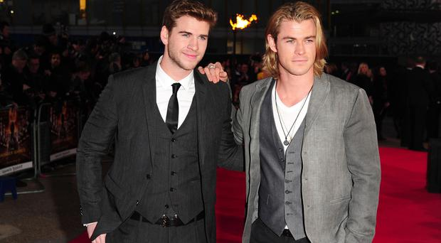 Liam (left) and Chris Hemsworth (right) at the premiere of The Hunger Games in London (Ian West/PA)