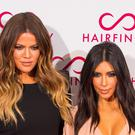 Khloe Kardashian and Kim Kardashian West (PA)