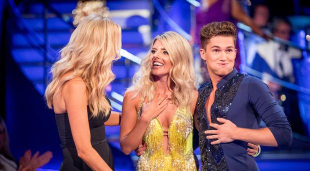 Tess Daly with Mollie King and AJ Pritchard (BBC/PA)