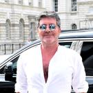 Simon Cowell is set to hear an audition from a familiar face on The X Factor (Ian West/PA)