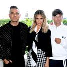Robbie Williams, Ayda Field Williams, Louis Tomlinson and Simon Cowell (Ian West/PA)