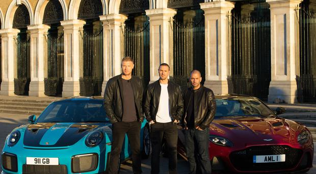 Andrew Flintoff, Paddy McGuinness and Chris Harris with a Porsche 911 GT2 RS and an Aston Martin DBS Superleggera at Billingsgate Market (David Parry/BBC/PA)