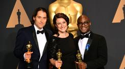 Jeremy Kleiner, Adele Romanski and Barry Jenkins with the award for Best Picture for Moonlight at the 89th Academy Awards (Ian West/PA)