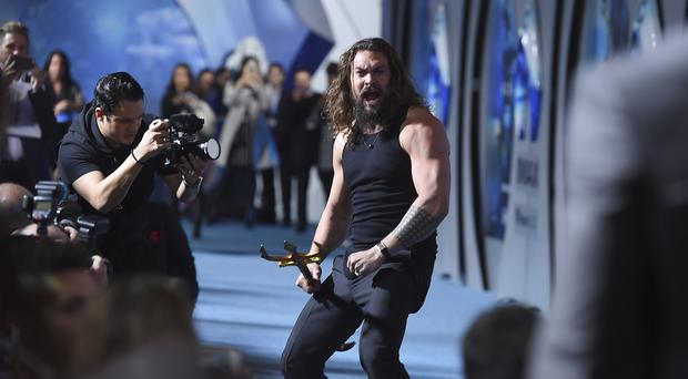 Jason Momoa arrives at the premiere of Aquaman at TCL Chinese Theatre on Wednesday, Dec. 12, 2018, in Los Angeles. (Photo by Jordan Strauss/Invision/AP)