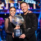 For use in UK, Ireland or Benelux countries only Undated BBC handout photo of finalists Kevin Clifton and Stacey Dooley with the Strictly Come Dancing glitterball trophy.