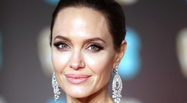 Jolie will seek to improve media literacy with the partnership on the new programme, Our World (Yui Mok/PA)