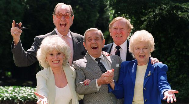 Veteran 'Carry On' film stars Jack Douglas (back left), Leslie Phillips (right rear), Barbara Windsor (front left) and June Whitfield with guest and comic actor Norman Wisdom, centre, (who did not star in any of the films) at a 40th Anniversary reunion in 1998 (Fiona Hanson/PA)