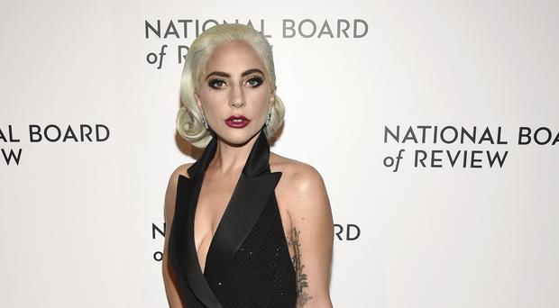 Lady Gaga has apologised for working with R Kelly amid allegations of sexual assault against the singer (Evan Agostini/Invision/AP)
