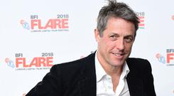 Hugh Grant has appealed for help after a script was stolen from his car (Ian West/PA)