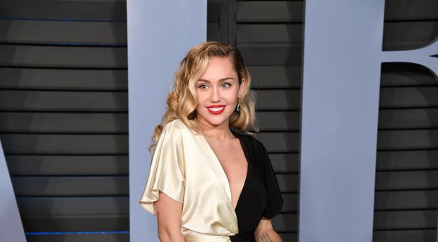 Miley Cyrus has denied she is pregnant (PA)