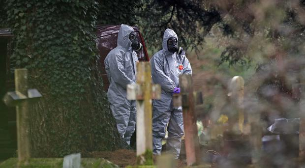 Forensic officers in gas masks in Salisbury (PA)