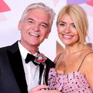 Philip Schofield and Holly Willoughby with the award for Best Daytime show (Ian West/PA)