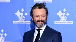 Michael Sheen stars in the show alongside David Tennant and John Hamm (Ian West/PA)
