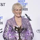 Glenn Close was accompanied by her dog on the blue carpet (Richard Shotwell/Invision/AP)