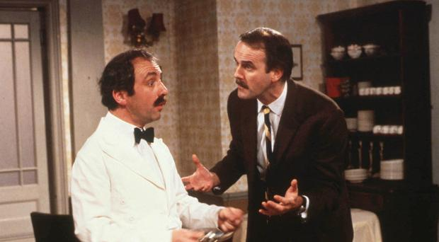 Andrew Sachs as Manuel (Left) and John Cleese as Basil in BBC's Fawlty Towers. (PA/BBC)