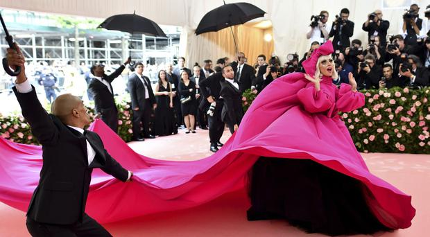 Lady Gaga arrived in a giant hot-pink gown and ended up in sparkling black lingerie (Charles Sykes/Invision/AP)