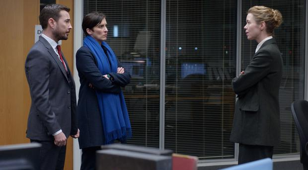 Anna Maxwell Martin (right) as Detective Chief Superintendent Patricia Carmichael in Line of Duty, with Martin Compston and Vicky McClure (PA)