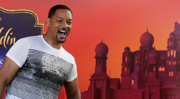 US actor Will Smith reacts during a news conference ahead of the regional launching of Disney's live-action Aladdin in the Jordanian capital Amman (Raad Adayleh/AP)