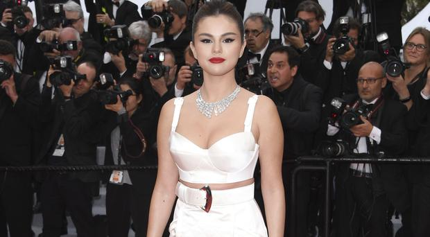 Actress Selena Gomez poses for photographers at the opening of the 72nd Cannes Film Festival (Arthur Mola/Invision/AP)