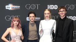 Maisie Williams, Kit Harington, Sophie Turner, and Isaac Hempstead Wright star in Game of Thrones (Liam McBurney/PA)