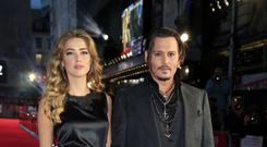 Johnny Depp has accused ex-wife Amber Heard of having 'painted on bruises' as he denied being physically abusive (Jonathan Brady/PA)