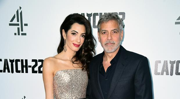 George and Amal Clooney are offering fans the chance to win a double date with them at their Lake Como home (Ian West/PA)
