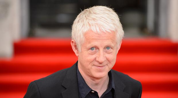 Richard Curtis will attend the Suffolk festival. (Dominic Lipinski/PA)