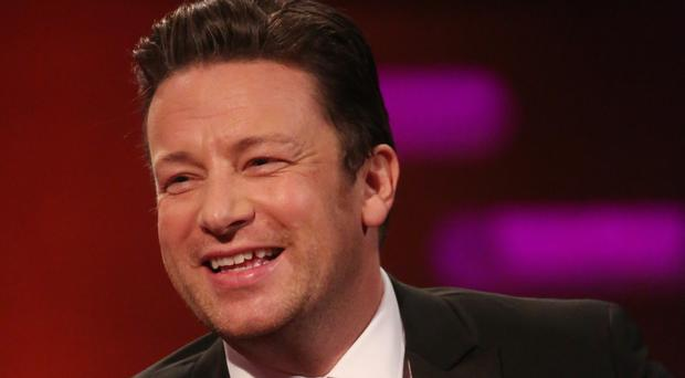 A documentary about Jamie Oliver will lift the lid on the collapse of his restaurant chain (Isabel Infantes/PA)