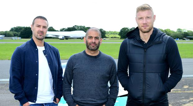 Paddy McGuinness, Chris Harris and Freddie Flintoff with a McLaren 600LT on the Top Gear test track (Ian West/PA)