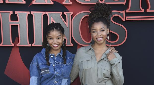 Halle Bailey, left, and Chloe Bailey, of Chloe X Halle, arrive at the season three premiere of Stranger Things (Jordan Strauss/Invision/AP)