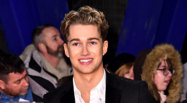 AJ Pritchard described his brother Curtis's dance moves as 'scarring' (Matt Crossick/PA)