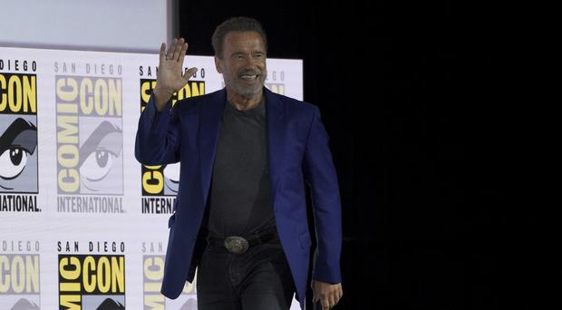 Arnold Schwarzenegger walks on stage at the Terminator: Dark Fate panel on day one of Comic-Con International (Chris Pizzello/Invision/AP)