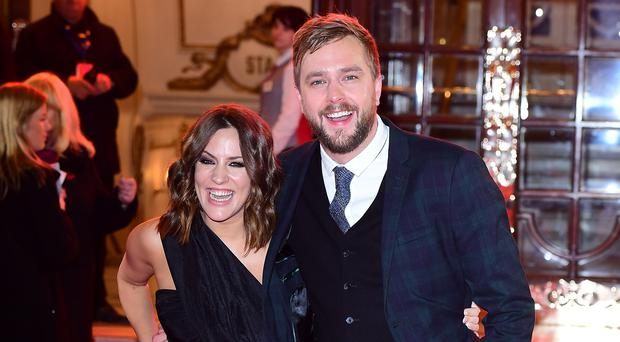 Hosts Caroline Flack and Iain Stirling (Ian West/PA)